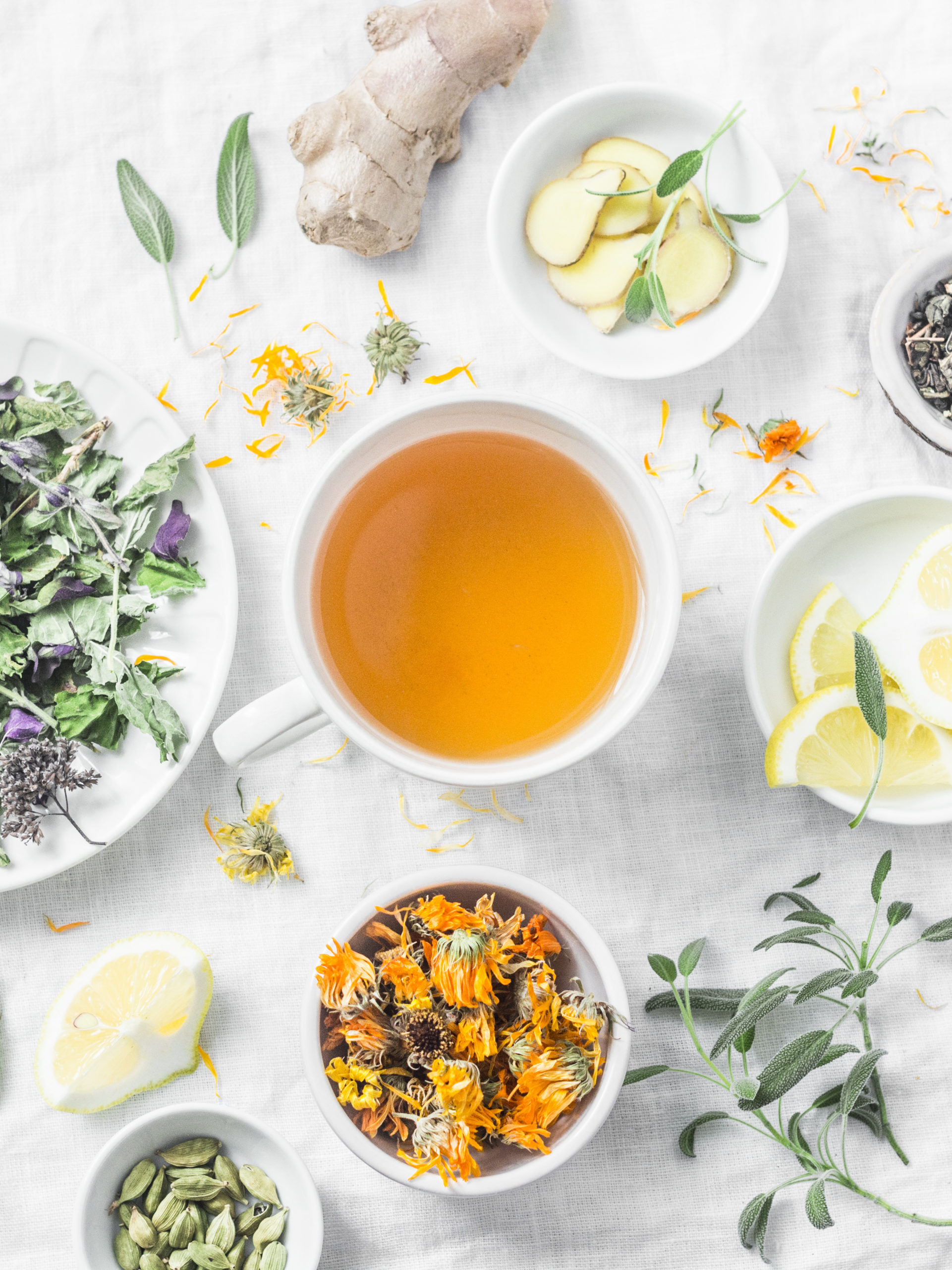 Herbal detox antioxidant tea and the ingredients for cooking on a light background, top view. Herbal homeopathic recipe